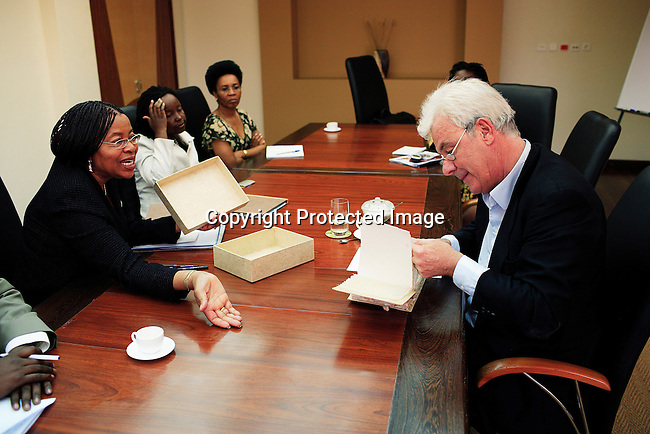 Graca Machel, the wife of Mandela Mandela talks to Peter Kraemer in her office on June 15, 2006 in Maputo, Mozambique. Mr. Kraemer was given a present from children. .Photo: Per-Anders Pettersson/Agentur Focus.