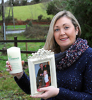 FARMING FEATURE ON FARM ACCIDENTS CHRISTMAS FEATURE: Majella Philpott holds a candle and a photo of here dad Dan Philpott who was killed in a farm accident three years ago.  The family have set up a group called 'Embrace Farm', where F.A.R.M. statnds for , Farming Accidents Remembered, Missed.<br /> Picture by Don MacMonagle