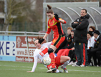 20140208 - OOSTAKKER , BELGIUM : duel  pictured between Belgian Heleen Jaques (r) and Polish Donata Lesnik (l) during a friendly soccer match between the women teams of Belgium and Poland , Saturday 8 February 2014 in Oostakker. PHOTO DAVID CATRY