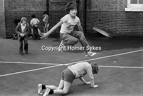 Playground games. South LOndon junior school 1970s England . UK..