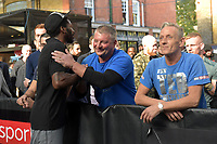 A member of Ted Cheeseman's team argues with opponent Asnia Byfield during a Public Workout at Old Spitalfields Market on 24th October 2018