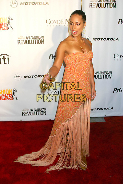 ALICIA KEYS.Conde' Nast Media Group Presents Fashion Rocks 2004   Radio City Music Hall in New York City..September 8, 2004 .headshot, portrait, orange halterneck dress, tassles.www.capitalpictures.com.sales@capitalpictures.com.© Capital Pictures
