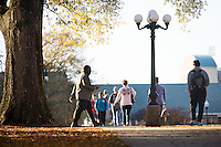 Student pedestrians with Drill Field lamppost and fall leaves<br />  (photo by Megan Bean / &copy; Mississippi State University)