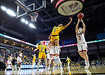 SIOUX FALLS, SD - MARCH 8: Lauren Loven #3 of the Denver Pioneers and Ryan Cobbins #5 of the North Dakota State Bison go up for a rebound at the 2020 Summit League Basketball Championship in Sioux Falls, SD. (Photo by Richard Carlson/Inertia)