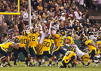 San Francisco, CA - October 13, 2011: USC offensive tackle Matt Kalil (75) blocks extra point. Cal Bears vs USC at AT&T Park in San Francisco, California. Final score Cal Bears 9, USC 30.