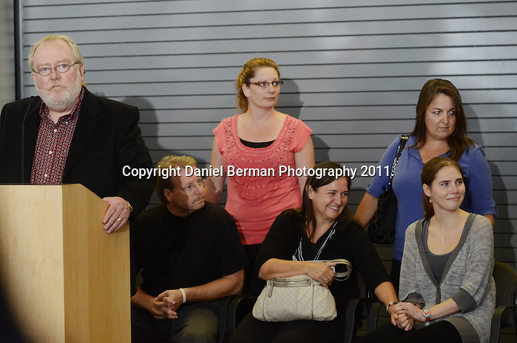 Amanda Knox, right, in gray, is comforted by friends and family members following her brief press conference upon her arrival in the United States in Seattle, Tuesday, Oct. 4. Photo by Daniel Berman/www.bermanphotos.com
