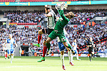 Ollie Palmer of Grimsby Town (left) challenges Will Puddy of Bristol Rovers (right) during the 2015 Vanarama Conference Promotion Final match between Grimsby Town and Bristol Rovers at Wembley Stadium, London<br /> Picture by David Horn/eXtreme aperture photography +44 7545 970036<br /> 17/05/2015