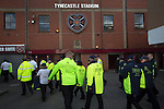 Heart of Midlothian 1 Birkirkara 2, 21/07/2016. Tynecastle Park, UEFA Europa League 2nd qualifying round. Security staff walking past the historic main stand at Tynecastle Park, Edinburgh before Heart of Midlothian played Birkirkara of Malta in a UEFA Europa League 2nd qualifying round, second leg. The match ended in victory for the Maltese side by 2-1 and they progressed on aggregate after the first match had ended 0-0. The game was watched by 14301 spectators, including 56 visiting fans of Birkirkara. Photo by Colin McPherson.