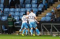Teammates celebrate with goal scorer Stuart Beavon (centre) of Coventry City as he makes it 1 0 during the The Checkatrade Trophy - EFL Trophy Semi Final match between Coventry City and Wycombe Wanderers at the Ricoh Arena, Coventry, England on 7 February 2017. Photo by Andy Rowland.