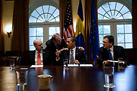 President Barack Obama confers with European Council High Representative Javier Solana, while Swedish Prime Minister Fredrik Reinfeldt, left, and European Commission President José Manuel Barroso, right,  listen during the U.S.-European Union Summit in the Cabinet Room of the White House, Nov. 3, 2009. (Official White House Photo by Pete Souza)<br /> <br /> This official White House photograph is being made available only for publication by news organizations and/or for personal use printing by the subject(s) of the photograph. The photograph may not be manipulated in any way and may not be used in commercial or political materials, advertisements, emails, products, promotions that in any way suggests approval or endorsement of the President, the First Family, or the White House.