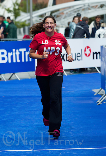 10 AUG 2014 - LIVERPOOL, GBR - Shadow Minister for Public Health, Luciana Berger completes the run for Team Liverpool MPs at the Tri Liverpool triathlon relay in Kings Dock in Liverpool, Great Britain  (PHOTO COPYRIGHT © 2014 NIGEL FARROW, ALL RIGHTS RESERVED)