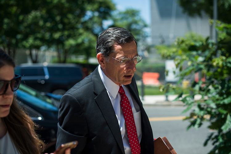 UNITED STATES - JUNE 12: Sen. John Barrasso, R-Wyo., talks with reporters before the Republican Senate Policy luncheon at the National Republican Senatorial Committee on June 12, 2018. (Photo By Tom Williams/CQ Roll Call)