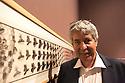 Federico Giudiceandrea, industrialist and collector, poses in front of Metamorphosis, bock print by Maurits Cornelis Escher, at Palazzo Reale in Milan June 23, 2016. Giudiceandrea is one of the curator of Escher exhibition at Palazzo Reale; he is also the main Escher collector in Europe. &copy; Carlo Cerchioli<br /> <br /> Federico Giudiceandrea, industriale e collezionista, posa davanti alla Metamorfosi, xilografia di Maurits Cornelis Escher, a Palazzo Reale, Milano 23 giugno 2016. Giudiceandrea &egrave; uno dei curatori della mostra su Escher ed &egrave; il pi&ugrave; grande collezionista privato europeo di Escher.