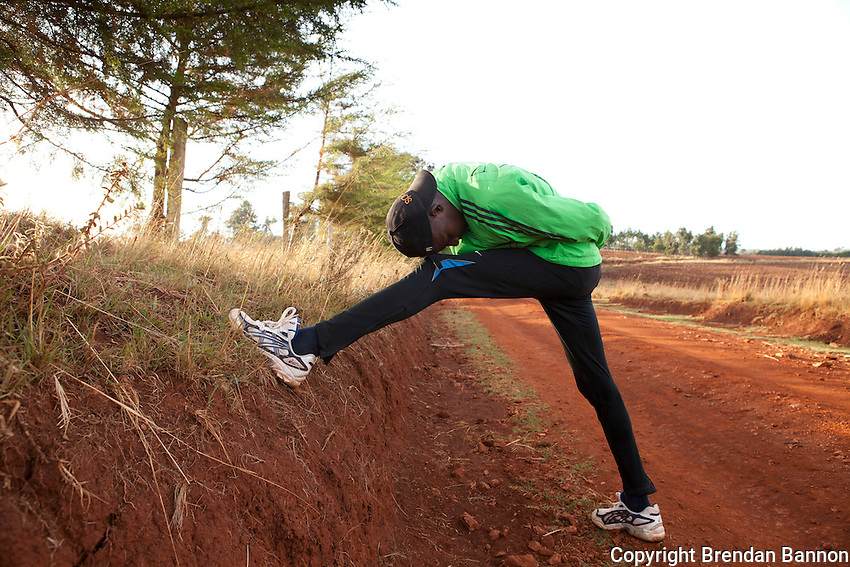 Athlete Johanna Kariankei stretches on the dirt track in Iten, the Kenyan town perched 8,000ft above sea level on the edge of the Rift Valley escarpment that has become the Mecca of high-altitude endurance training for the world's best long-distance runners. Few of these amateurs have access to professional facilities, yet the town hosts many of the fastest men and women over marathon, half-marathon and 10,000m distances.