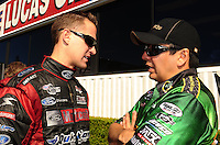 Nov 14, 2010; Pomona, CA, USA; NHRA funny car driver Bob Tasca III (left) talks with Tony Pedregon during the Auto Club Finals at Auto Club Raceway at Pomona. Mandatory Credit: Mark J. Rebilas-