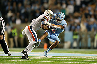 CHAPEL HILL, NC - NOVEMBER 02: Chazz Surratt #21 of the University of North Carolina tackles PK Kier #6 of the University of Virginia during a game between University of Virginia and University of North Carolina at Kenan Memorial Stadium on November 02, 2019 in Chapel Hill, North Carolina.