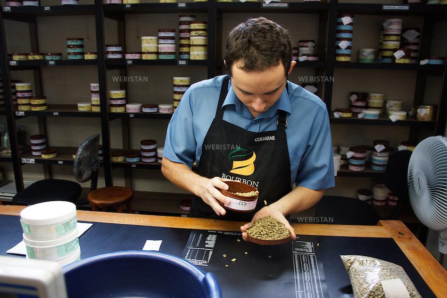 Bresil, etat Minas Gerais, Pocos de Caldas, 1er novembre 2012.<br /> <br /> Societe Bourbon Speciality Coffee, negociant-exportateur de cafe, partenaire de Nespresso dans le cadre du programme AAA. Fondee en 2000, elle est reconnue dans tout le Bresil pour l'extreme qualite de ses grains et a recu de prestigieuses recompenses telles que &quot;Cup of Excellence&quot; et &quot;Late Harvest&quot;.<br /> Guillerme s'assure de la qualite olfactive du cafe vert avant la pesee.<br /> Reportage les Chants de cafe_soul of coffee, realise sur les acteurs terrain du programme de developpement durable Triple AAA de Nespresso.<br /> <br /> Brazil, Minas Gerais, Pocos de Caldas, November 1, 2012 <br /> <br /> The company, Bourbon Specialty Coffees, is a commercial exporter of coffee and a partner of Nespresso AAA program. Founded in 2000, the company is known throughout Brazil for the high quality of its coffee beans and it has received prestigious awards such as the &ldquo;Cup of Excellence&rdquo; and &ldquo;Late Harvest.&rdquo;<br /> Guillerme smells the green coffee beans before weighing them to ensure they are good quality.  <br /> Assignment: les Chants de cafe_ Soul of Coffee, implemented on the fields of Nespresso&rsquo;s AAA Sustainable Quality Program.