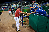 Batavia Muckdogs Troy Johnston (27) high fives young fans after a NY-Penn League game against the Lowell Spinners on July 11, 2019 at Dwyer Stadium in Batavia, New York.  Batavia defeated Lowell 5-2.  (Mike Janes/Four Seam Images)