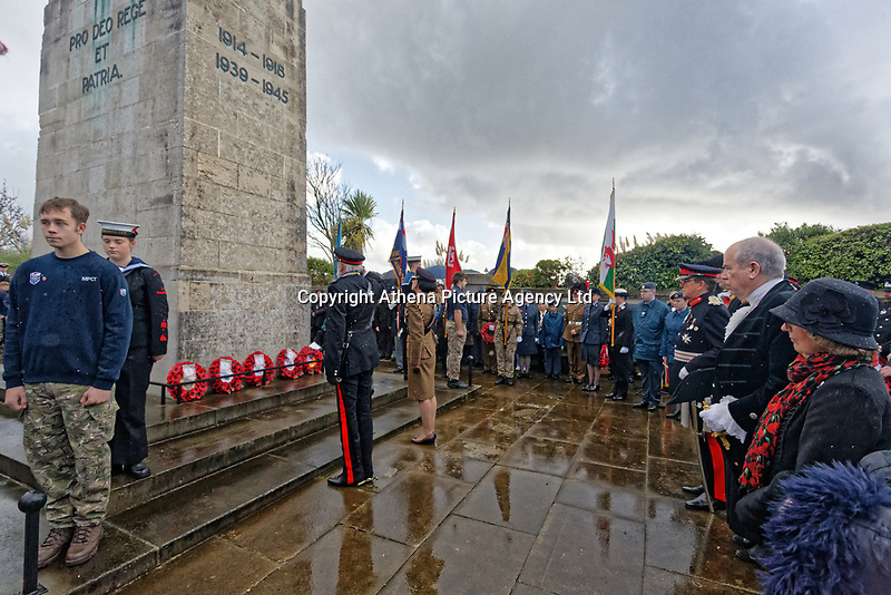 Pictured: Members of the Armed Forces salute after laying wreaths. Sunday 11 November 2018<br /> Re: Commemoration for the 100 years since the end of the First World War on Remembrance Day at the Swansea Cenotaph in south Wales, UK.