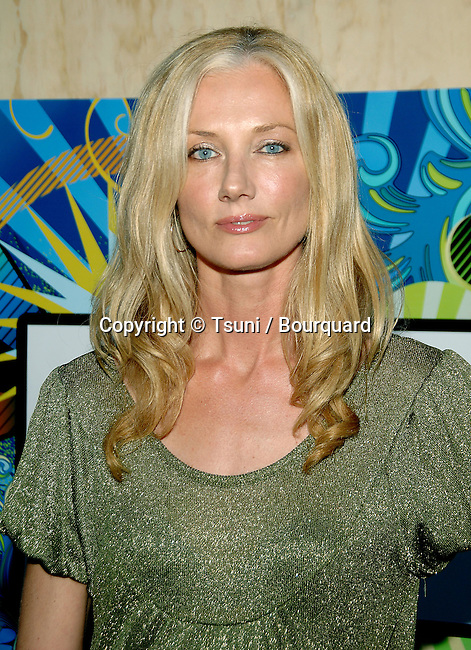 Joely Richardson arriving at the tca ( television critic association )  FOX Summer party on the Santa Monica Pier in Los Angeles.<br /> <br /> headshot<br /> eye contact<br /> green dress