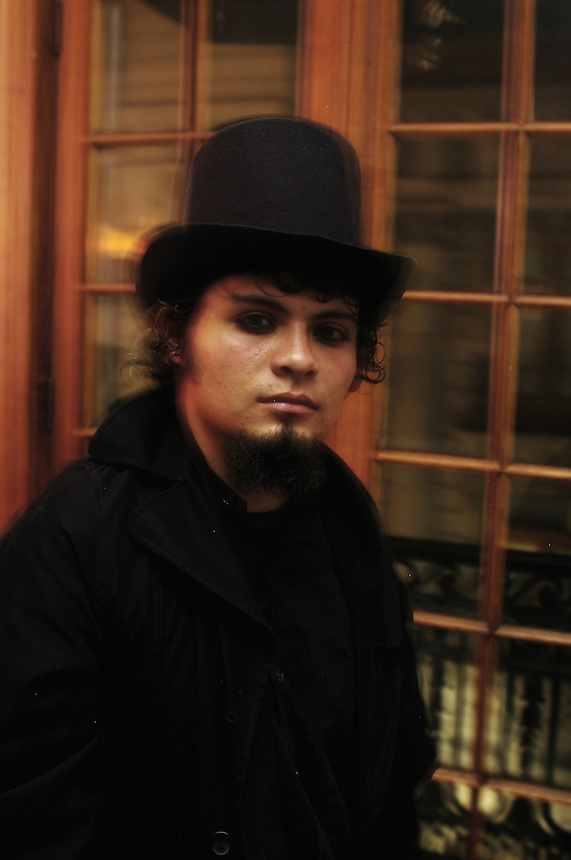 "A man poses in his top hat. ""Darkies"" or ""Goths"" at one of the Dada X parties in the historic center of Mexico City. August 28, 2005"