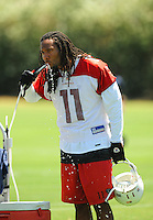 Jun 9, 2008; Tempe, AZ, USA; Arizona Cardinals wide receiver (11) Larry Fitzgerald drinks water during mini camp at the Cardinals practice facility. Mandatory Credit: Mark J. Rebilas-