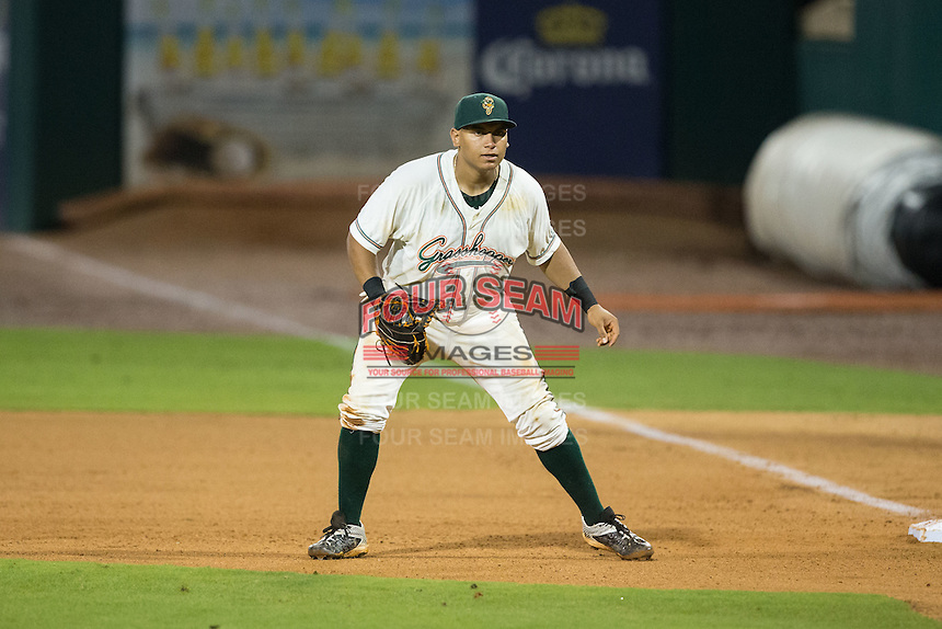 Greensboro Grasshoppers first baseman Josh Naylor (10) on defense against the Kannapolis Intimidators at NewBridge Bank Park on July 7, 2016 in Greensboro, North Carolina.  The Dash defeated the Pelicans 13-9.  (Brian Westerholt/Four Seam Images)