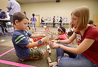 NWA Democrat-Gazette/BEN GOFF @NWABENGOFF<br /> Abby Terlouw, teen volunteer, helps William Stone, 6, of Bentonville build with pencils and cardboard tubes on Saturday Sept. 12, 2015 during the Invention Convention tinkering program at the Bentonville Public Library. The library supplied materials and resources for children and families to engage their 'inner inventor' and create whatever their imaginations could come up with.