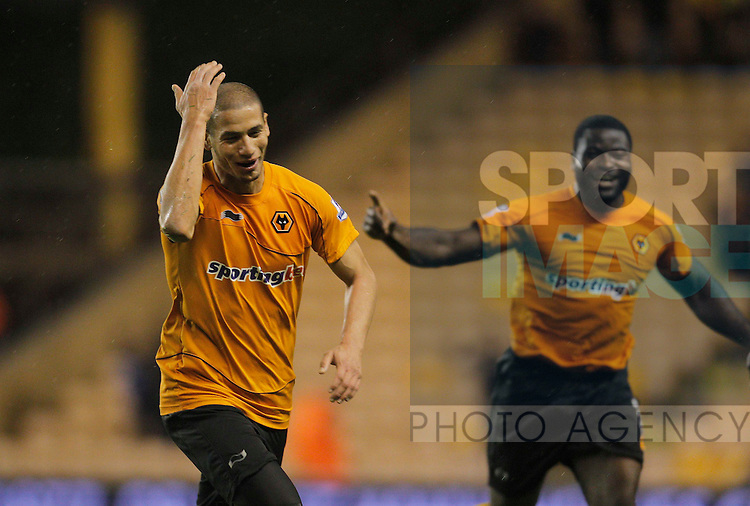 Adlene Guedioura of Wolverhampton Wanderers celebrates his magnificent goal, Wolves i5th of the game at Molineux