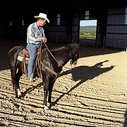 Cowboy Church. Texas, USA. 2007. A parishioner of the church on his horse at sunset just before roping night at the cowboy church.