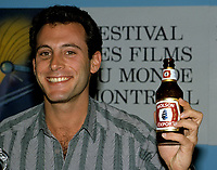 American television and film director and producer Charles Winkler, hold a Molson export canadian beer during a news conference at Montreal World Film Festival, circa 1986<br /> <br /> <br /> PHOTO : Agence Quebec Presse