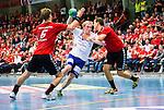 Eskilstuna 2014-10-03 Handboll Elitserien Eskilstuna Guif - Alings&aring;s HK :  <br /> Sk&ouml;vdes Joel J&auml;rlfors stoppas av Eskilstuna Guifs Viktor &Ouml;stlund och Robin Andersson <br /> (Foto: Kenta J&ouml;nsson) Nyckelord:  Eskilstuna Guif Sporthallen IFK Sk&ouml;vde HK