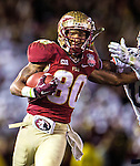 FSU wide receiver Rashad Greene makes a reception on the final drive of the BCS national title game at the Rose Bowl in Pasadena, California on January 6, 2014.  Florida State Seminoles defeated the Auburn Tigers 34-31.