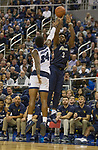 Akron forward Daniel Utomi (3) shoots a three pointer      over Nevada's Jordan Caroline (24) in the second half of an NCAA college basketball game in Reno, Nev., Saturday, Dec. 22, 2018. (AP Photo/Tom R. Smedes)
