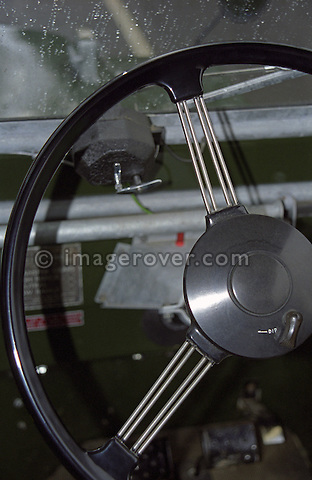 Metal spoke design steering wheel with dip switch on a perfectly restored and award winning 1953 Land Rover Series One 80 inch. --- No releases available. Automotive trademarks are the property of the trademark holder, authorization may be needed for some uses.