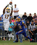 BROOKINGS, SD - SEPTEMBER 14:  Isaiah Kepley # 17 from Southeastern Louisiana leaps for a catch in front of Je Ryan Butler #22 from South Dakota State University in the first quarter of their game Saturday night at Coughlin Alumni Stadium in Brookings. (Photo by Dave Eggen/Inertia)