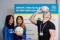 FaFriday 10 February 2017<br /> Pictured: Faults advisor Mathew Davies balances a rugby ball on his head <br /> Re:Welsh Government Dementia Risk Prevention Roadshow at the BT building, Swansea, Wales, UK