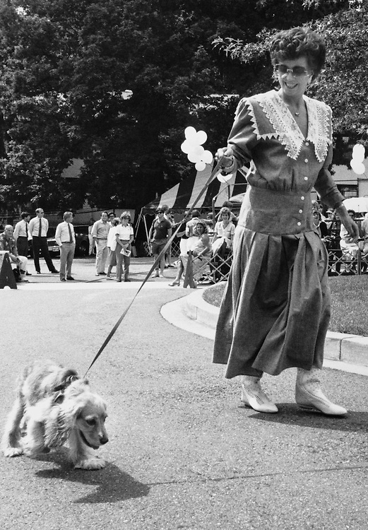 Mrs. Jim Wright walking with her pet dog. (Photo by CQ Roll Call)