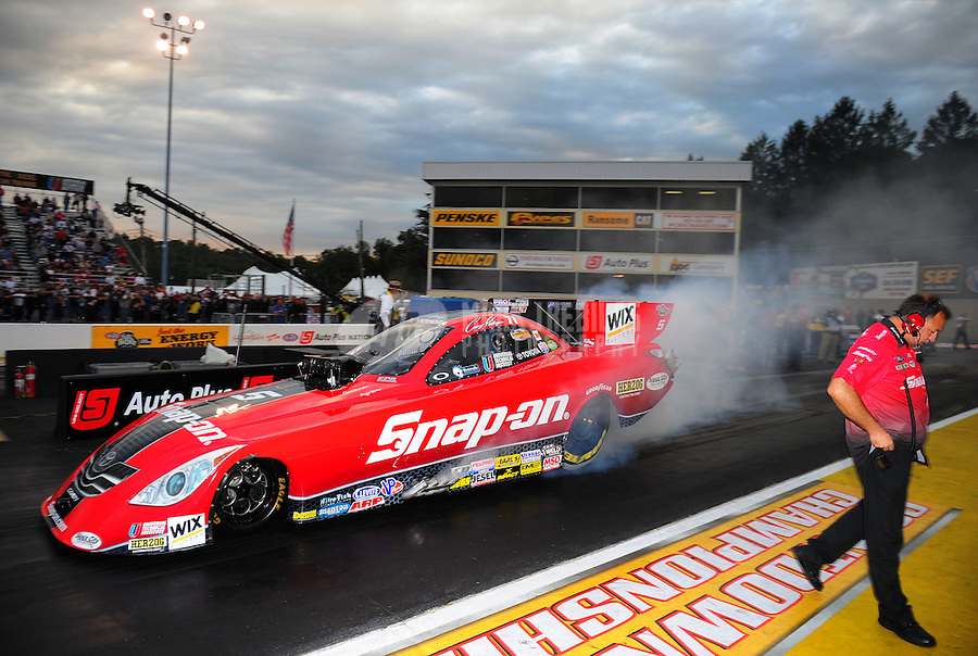 Sept. 30, 2011; Mohnton, PA, USA: NHRA crew members for funny car driver Cruz Pedregon during qualifying for the Auto Plus Nationals at Maple Grove Raceway. Mandatory Credit: Mark J. Rebilas-