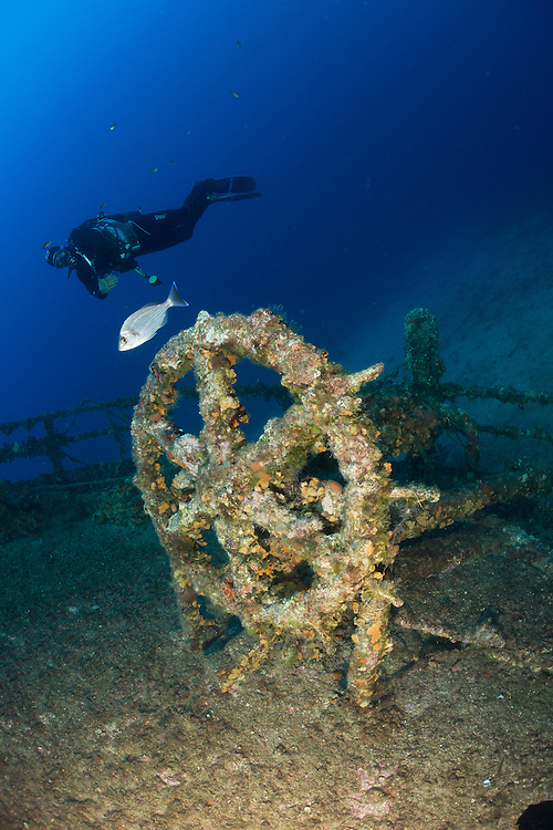 Divers exploring the wreck of the Teti which lies between 10 and 33 metres