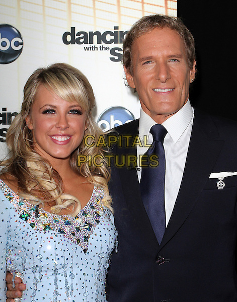 "CHELSIE HIGHTOWER & MICHAEL BOLTON .""Dancing With The Stars"" Season Premiere held at CBS Studios, Los Angeles, CA, USA..September 20th, 2010.half length black suit blue dress  beads beaded.CAP/ADM/KB.©Kevan Brooks/AdMedia/Capital Pictures."