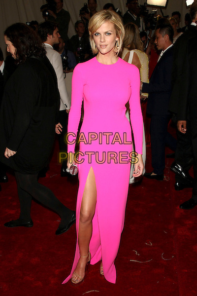 "BROOKLYN DECKER .attending the Metropolitan Museum of Art's Costume Institute Gala ""Alexander McQueen: Savage Beauty"" held at the Metropolitan Museum of Art, New York, NY, USA, May 2nd 2011..full length pink dress long sleeve maxi slit split Fuchsia.CAP/LNC.©TOM/LNC/Capital Pictures."