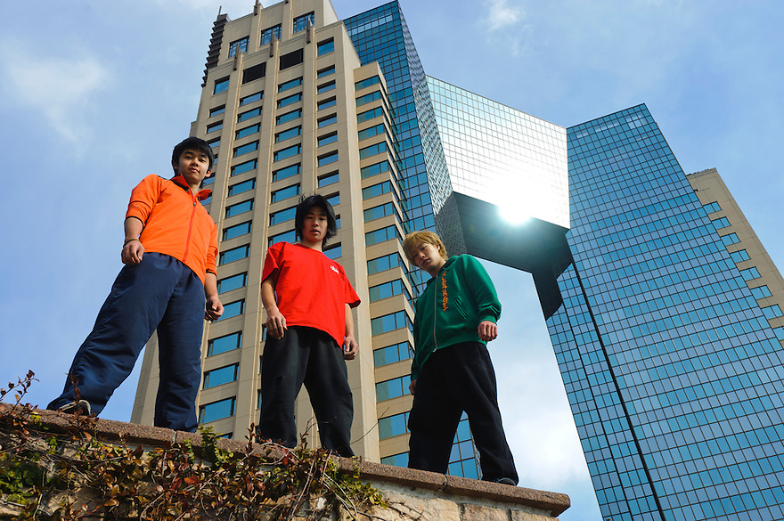 "(L to R) Traceurs (Parkour practitioners) Jun ""Sullivan"" Sato, ""Yutaro"" and ""Zen"". Practicing Parkour in Odaiba, Tokyo, Japan, January 27, 2012. Parkour is a modern method of physical training, also known as freerunning. It was founded in France in the 1990s. There is a small group of around 50 parkour practitioners in Tokyo."