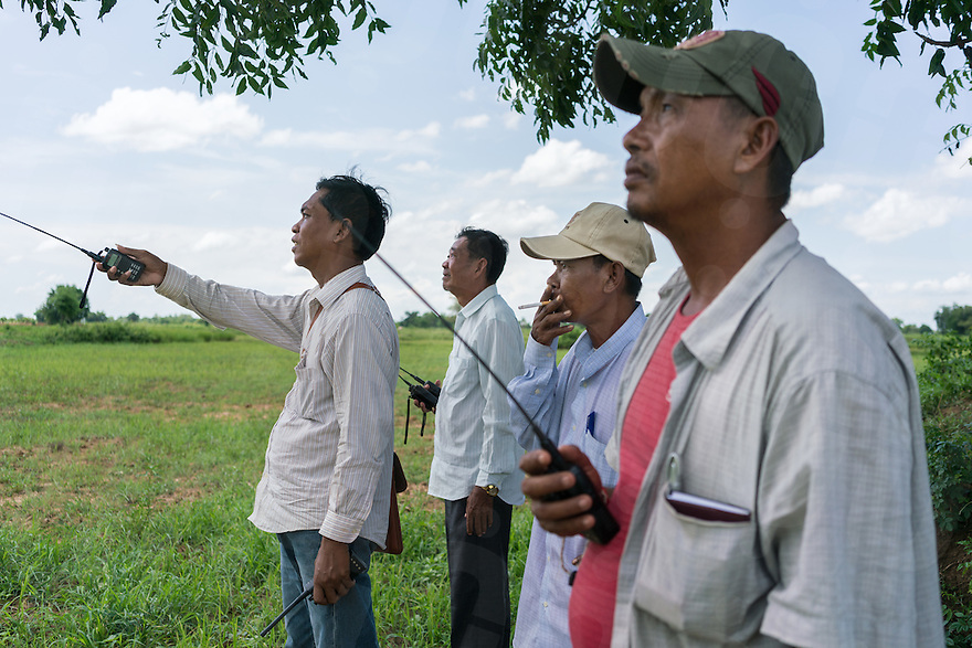 August 25, 2016 - Battambang (Cambodia). Rain spotters look at the weather condition from a rice field in the outskirts of Battambang and update bidders with a radio transmitter. © Thomas Cristofoletti / Ruom