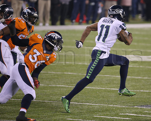 02.02.2014. East Rutherford, NJ, USA. Percy Harvin (11) of the Seattle Seahawks returns the second-half kick off for a touchdown against the Denver Broncos in Super Bowl XLVIII at MetLife Stadium in East Rutherford, N.J., on Sunday, Feb. 2, 2014