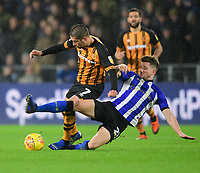 Hull City's Evandro Goebel is tackled by Sheffield Wednesday's Sam Hutchinson<br /> <br /> Photographer Chris Vaughan/CameraSport<br /> <br /> The EFL Sky Bet Championship - Hull City v Sheffield Wednesday - Saturday 12th January 2019 - KCOM Stadium - Hull<br /> <br /> World Copyright © 2019 CameraSport. All rights reserved. 43 Linden Ave. Countesthorpe. Leicester. England. LE8 5PG - Tel: +44 (0) 116 277 4147 - admin@camerasport.com - www.camerasport.com