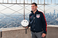 Former men's national team player Tab Ramos poses for a photo on the observation deck of the Empire State Building during the centennial celebration of U. S. Soccer in New York, NY, on April 05, 2013.