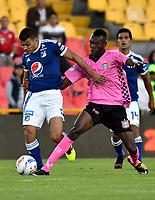 BOGOTÁ - COLOMBIA, 22-07-2018: Jhon Duque (Izq.) jugador de Millonarios disputa el balón con Jhon Arboleda (Der.) jugador de Boyacá Chicó F. C., durante partido de la fecha 1 entre Millonarios y Boyacá Chicó F. C., por la Liga Aguila II-2018, jugado en el estadio Nemesio Camacho El Campin de la ciudad de Bogota. / Jhon Duque (L) player of Millonarios vies for the ball with Jhon Arboleda (R) player of Boyaca Chico F. C., during a match of the 1st date between Millonarios and Boyaca Chico F. C., for the Liga Aguila II-2018 played at the Nemesio Camacho El Campin Stadium in Bogota city, Photo: VizzorImage / Luis Ramirez / Staff.