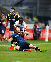 Madosh Tambwe of the Cell C Sharks tackling Michael Collins of the Pulse Energy Highlanders during the Super Rugby match between the Pulse Energy Highlanders and the Cell C Sharks at the Forsyth Barr Stadium in Dunedin, New Zealand on Friday, 7 February 2020. Photo Steve Haag / stevehaagsports.com
