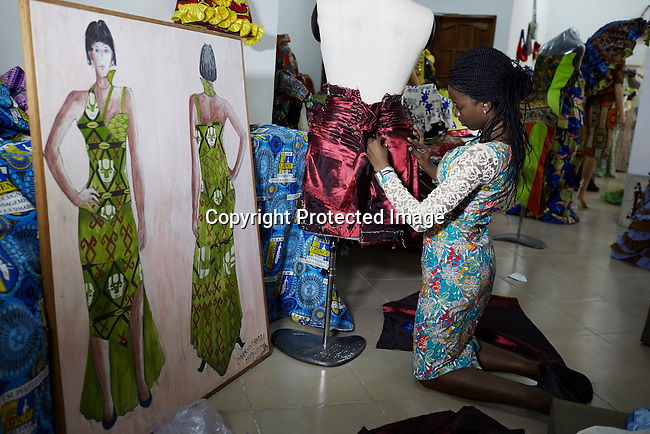 KINSHASA, DRC - JULY 18: A fashion student works on a garment at Institut Supérieur des Arts et Métiers (ISAM) fashion school in Kinshasa, DRC. Some of the students participated in Kinshasa Fashion Week on July 18, 2014, at Shark club in Kinshasa, DRC. Local and invited foreign-based designers showed their collections during the second edition of Kinshasa Fashion week. (Photo by Per-Anders Pettersson)